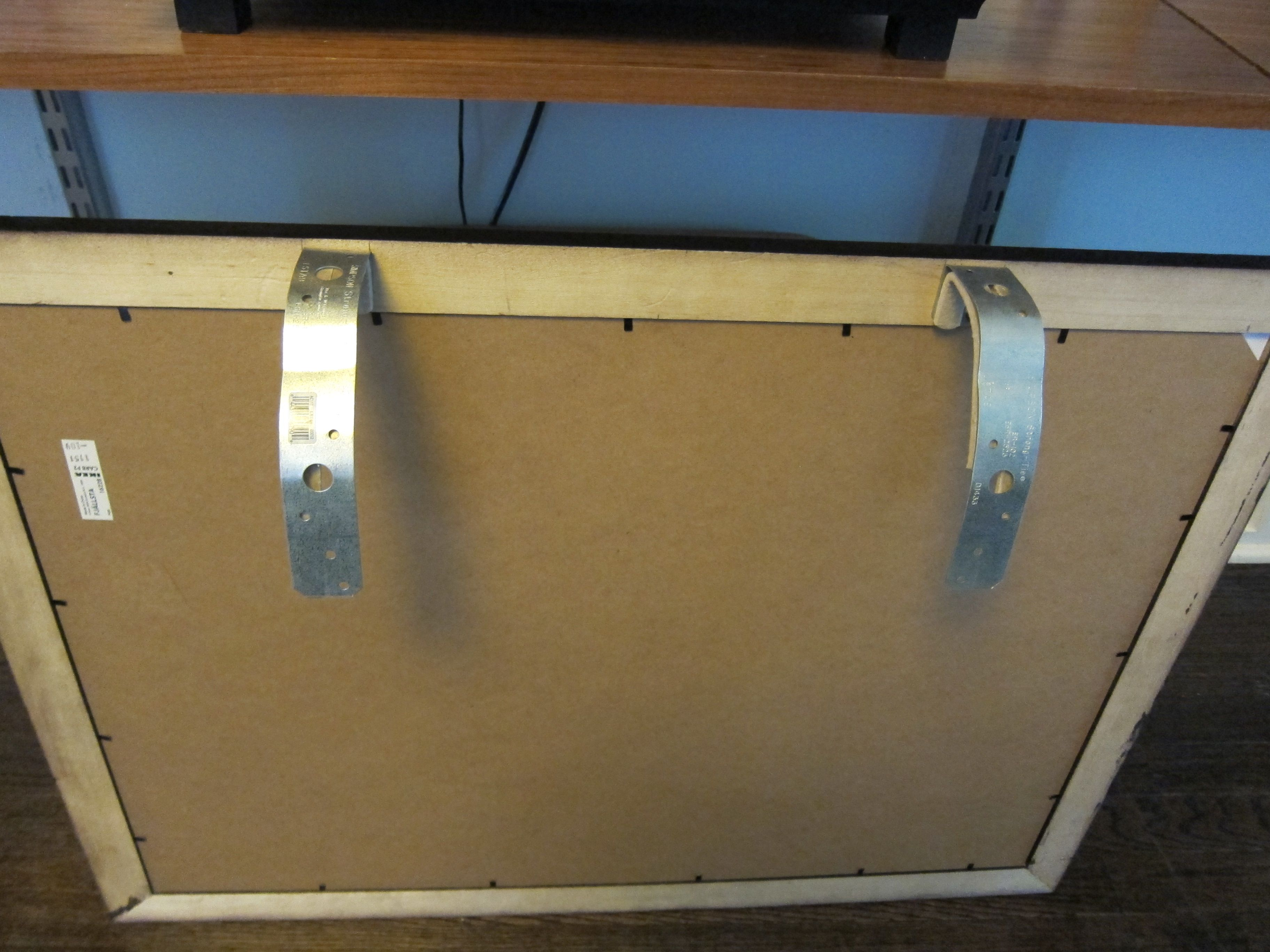 How To Hang A Picture Over A Tv To Cover It Up Attach Bent Metal