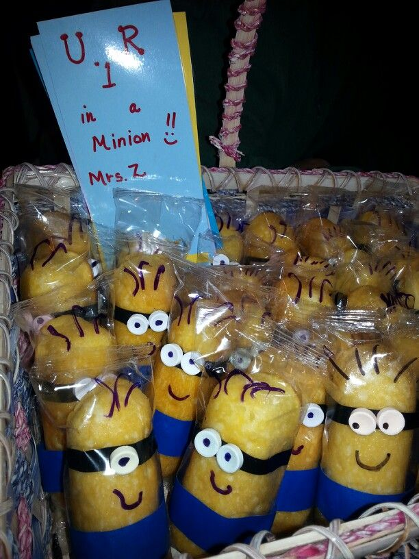 Happy Minions*******   store brand twinkies.  For glasses I cut black electrical in half for the glasses and sweet tarts for eyes. I used glue dots to hold on eyes. Blue painter's tape is used for the pants.  Take a marker and give your Minions a personality all their own.