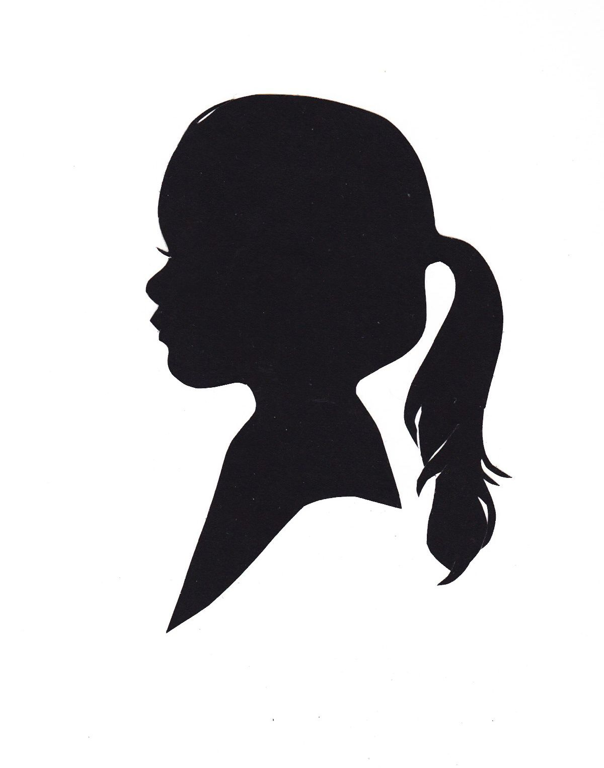 Silhouette of a little girl with ponytail