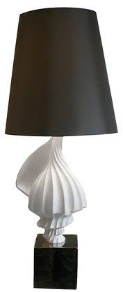 Jonathan Adler Seashell Lamp $495.00 Simple lines modernize natural beauty.  Product Measures: 15 W x 37.5 H   Manufactured in: China  Material: Porcelain
