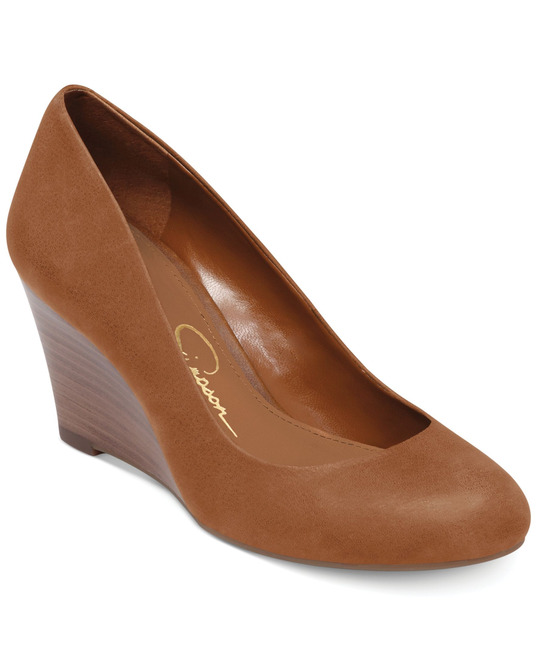 988fd61421c Jessica Simpson s Sampson wedge pumps feature a faux-stacked wrapped wedge  heel.