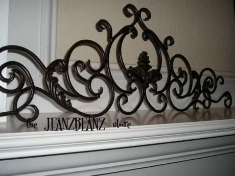 Hang a wrought iron wall decor in closet to organize scarves! Love ...