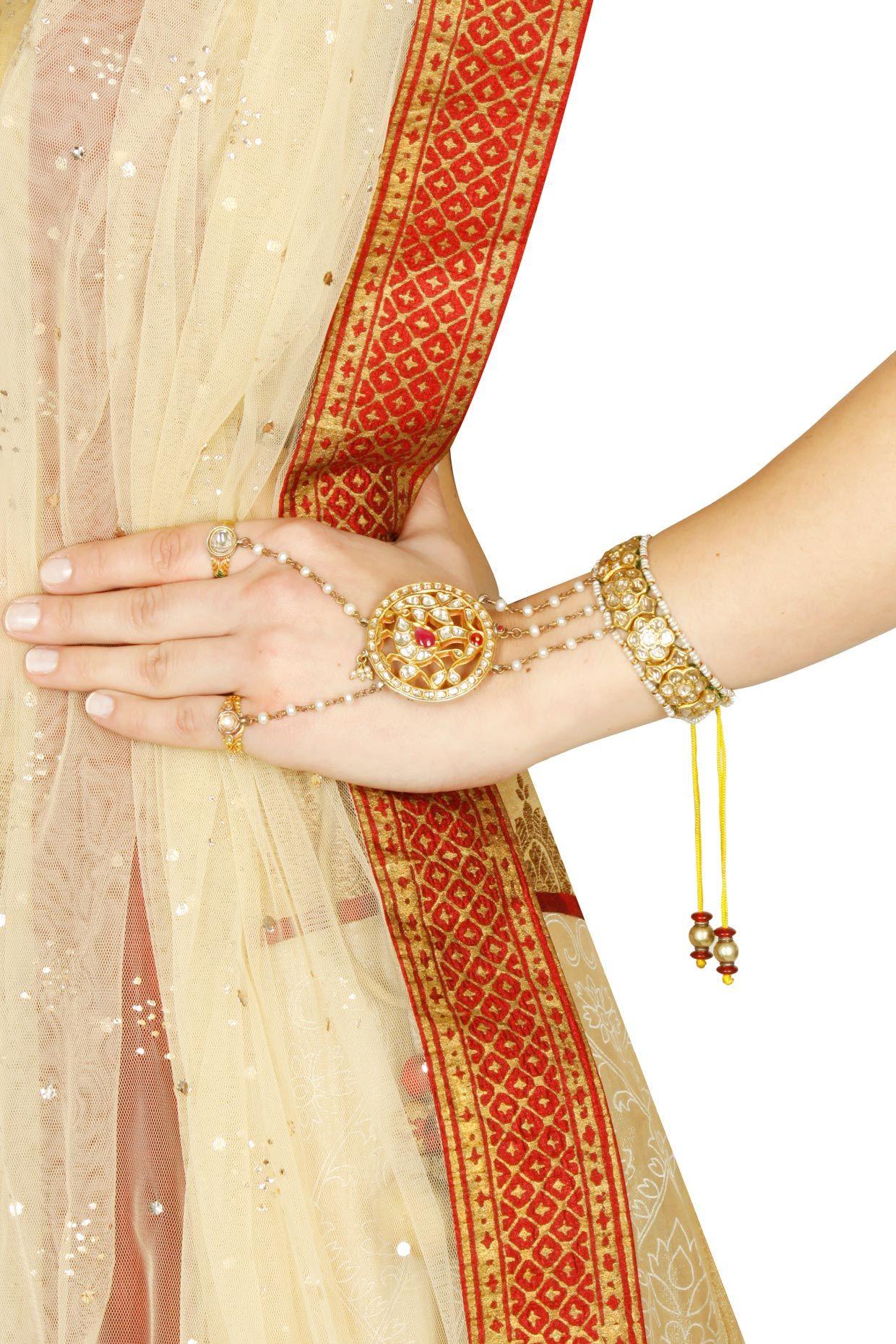 Diamond, polki and rubies studded pure gold two ring haathphool ...