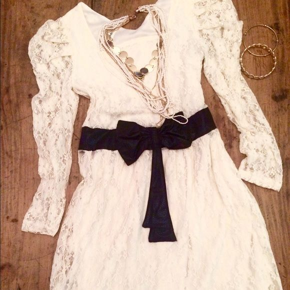 White Lace Dress with Bow Cute lace dress with a complimenting black bow around the waist. Comes just above the knees and has slightly puffy sleeves. Super cute. No problems. Never worn. Sisouhor Dresses Midi