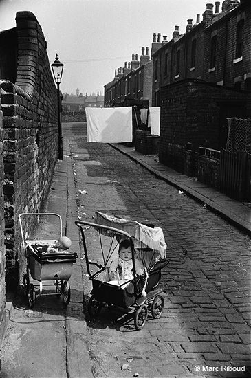 Leeds, 1954 by Marc Riboud note the washing strung out to dry in the back alley.The baby & the dolls pram would all be safe. How times have changed !
