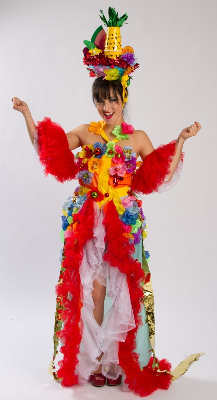 Sneak peek from our employee DIY costumes contest! Selene totally wowed us in this DIY Carmen Miranda costume she created from leis, tulle, duck tape, plastic table covers, fruit cutouts, floral sheeting and party cups (that pineapple hat!) ... It just makes us wanna samba!