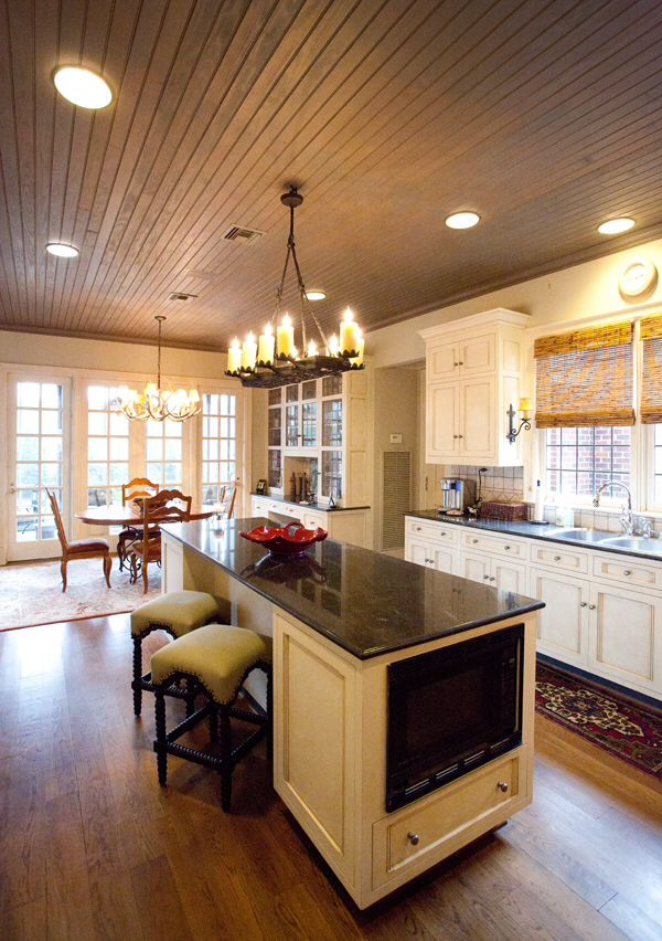 Cottage style in a kitchen with rustic wood ceiling and ...