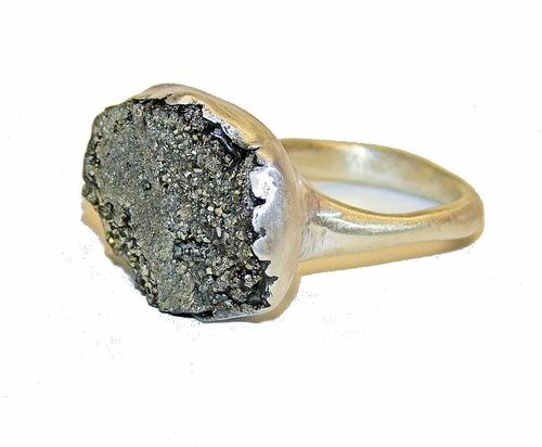 This ring is chunky and awesome. My favorite for spring. Silver and pyrite.