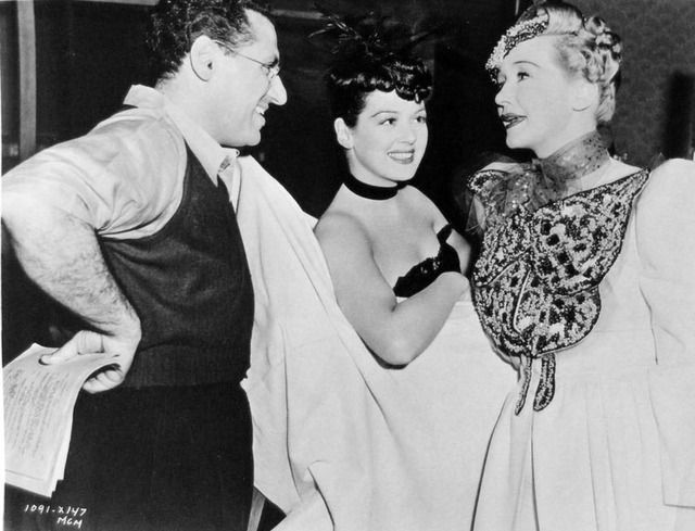 George Cukor, Rosalind Russell, and Hedda Hopper on the set of The Women