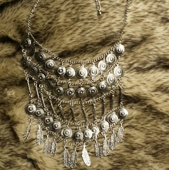 Coin and Feather Statement Necklace Long silver statement necklace. Never been used. Jewelry Necklaces