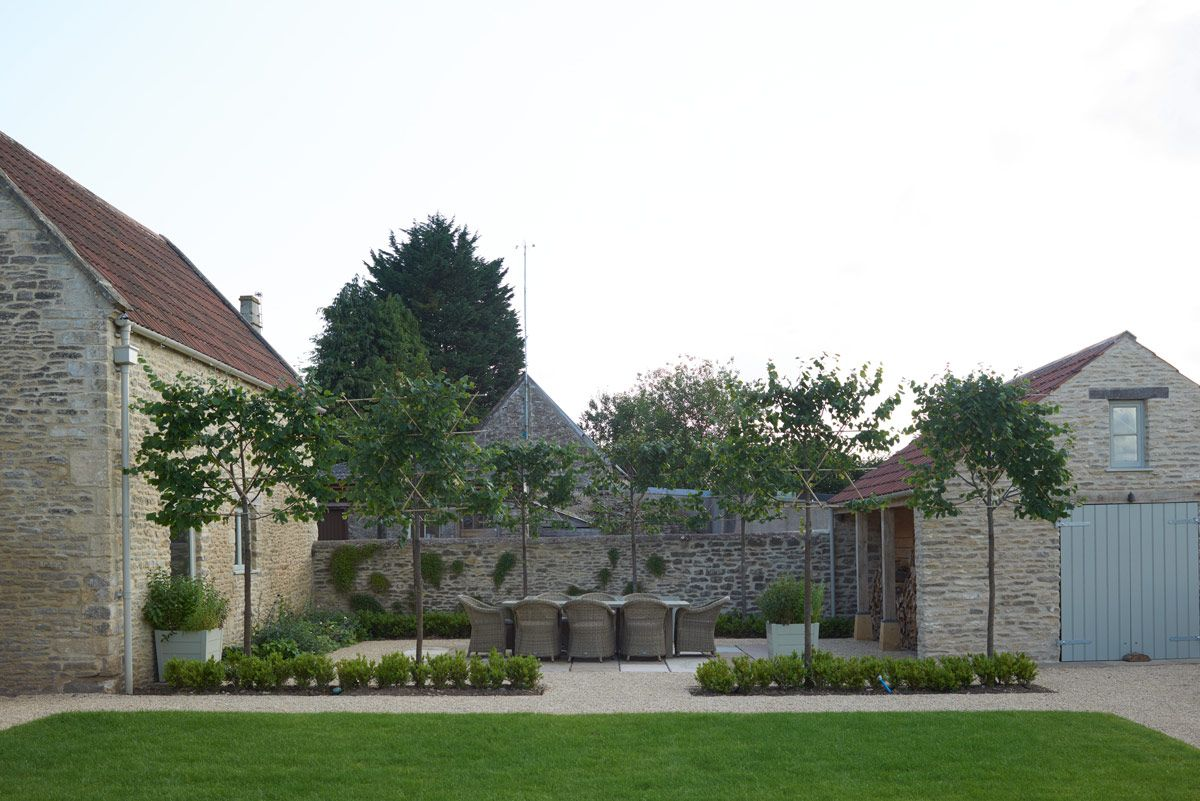 garden seating #gardencare Modern Country Cotswold House And Garden Tour: The White Hart by Sims Hilditch