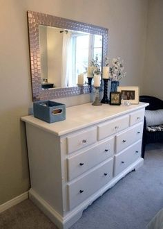 I love the idea of a wall-mounted mirror over a DIY painted dresser as an alternative to a vanity or dresser w/ attached mirror. Looks clean and modern!   best stuff