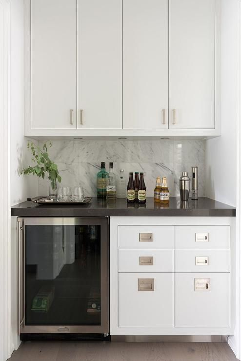 Modern Bar Features An Under Counter Glass Front Beverage Fridge Which Stands Next To Wet Drawers Finished With Campaign Hardware Topped Black