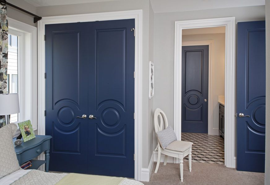 By Painting The Fashion Forward Solid Interior Doors A Vibrant Blue Hue,  They Become Striking