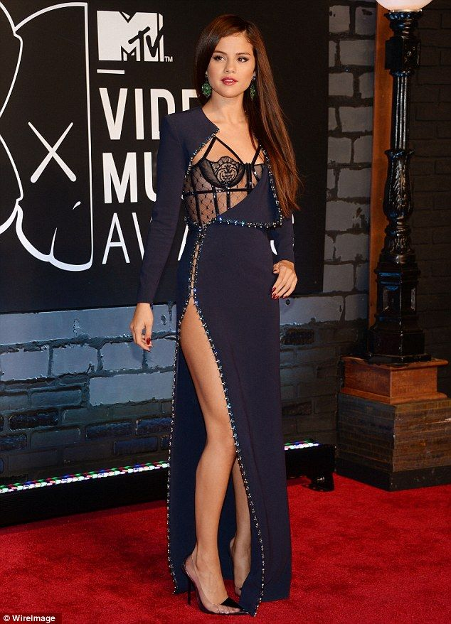 Peek-a-boo! Selena Gomez stuns in daring dress with sheer bustier and thigh-high split at MTV VMAs