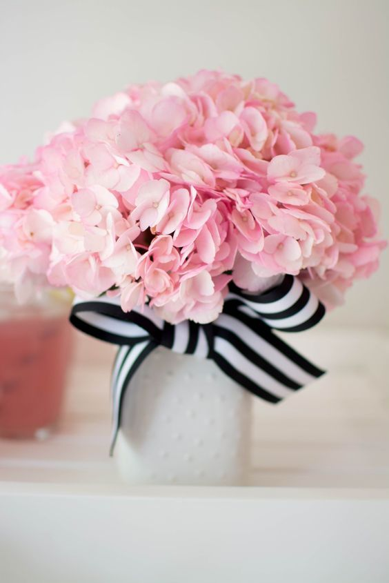 A neutral vase with a striped black and white bow and pink flowers a neutral vase with a striped black and white bow and pink flowers mightylinksfo Image collections