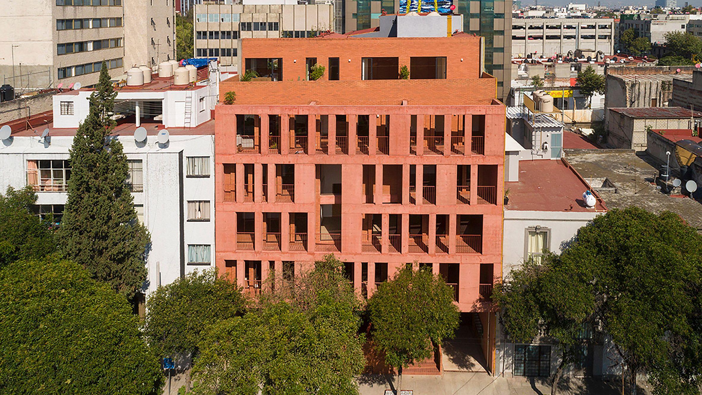 Reddish Facades Generous Balconies And Open Air Corridors Define