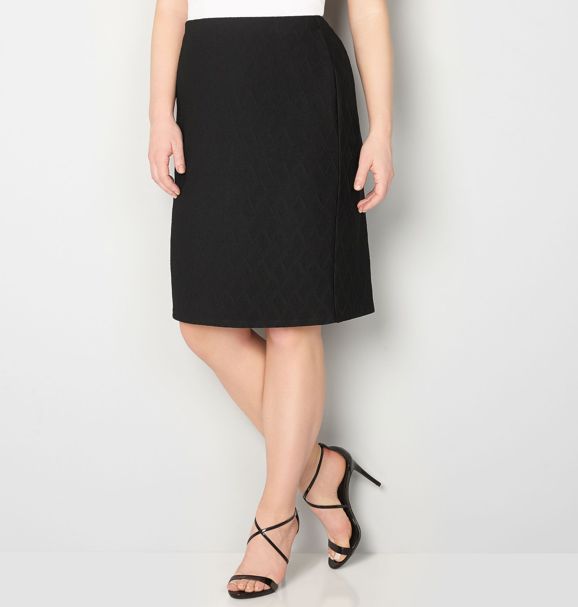 Amp up the style of a simple solid skirt with a chic diamond textured pattern all over. An elastic waistband makes this an easy wear while a slit at the back adds a sexy touch.    Polyester/spandex. Machine wash. Imported.  Approx. 25 inches long.