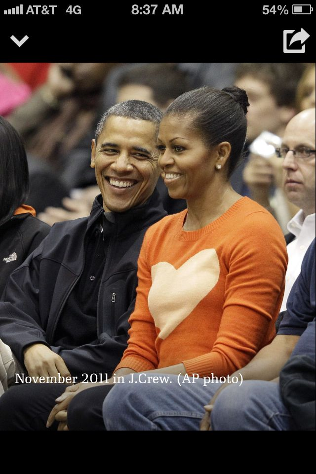 The Obamas at a basketball game. Michelle Obama in J Crew heart sweater, 2011