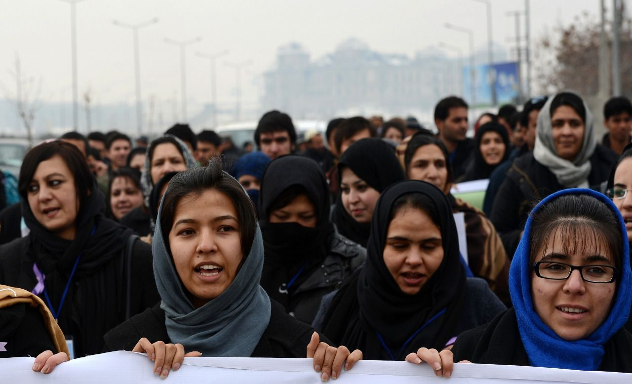 Afghan women march during a protest in Kabul in 2013. SHAH MARAI/AFP/Getty Images)
