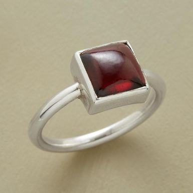 GARNET CARRE SOLITAIRE--A square garnet cabochon stands out on a rounded sterling silver band. Handcrafted exclusively for Sundance. Whole and half sizes 5 to 9.
