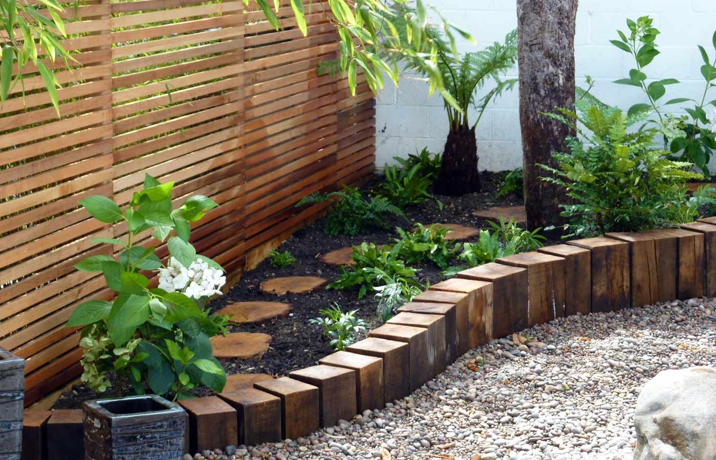 Wooden Stepping Stones Amongst The Plants And Lovely Edging!