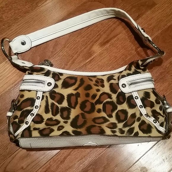 Leopard purse Small leopard purse. Like new condition. Used only a handful of times. Kathy Van Zeeland Bags Mini Bags