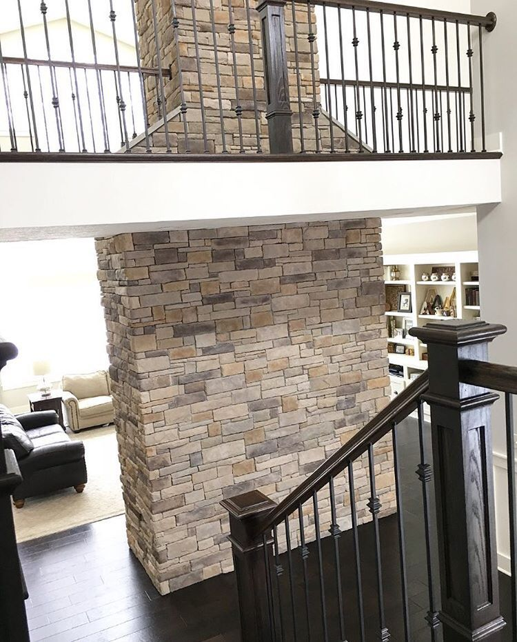 Two Story Modern Farmhouse Foyer With Stone Fireplace And Catwalk Hallway