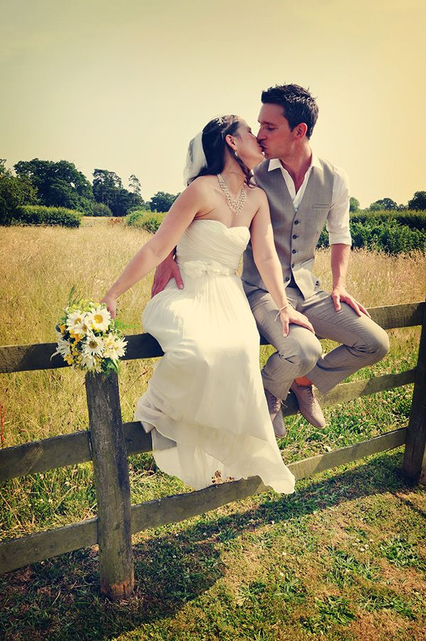 Country wedding - bride & groom kiss