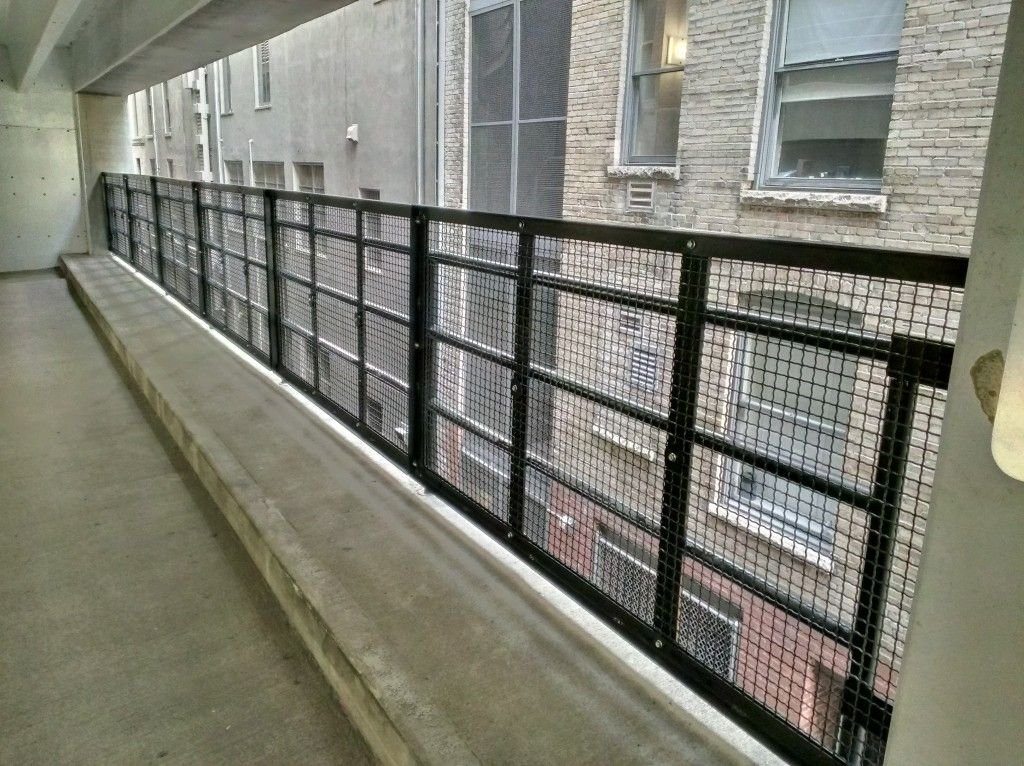 Steel commercial railing system with stainless cable