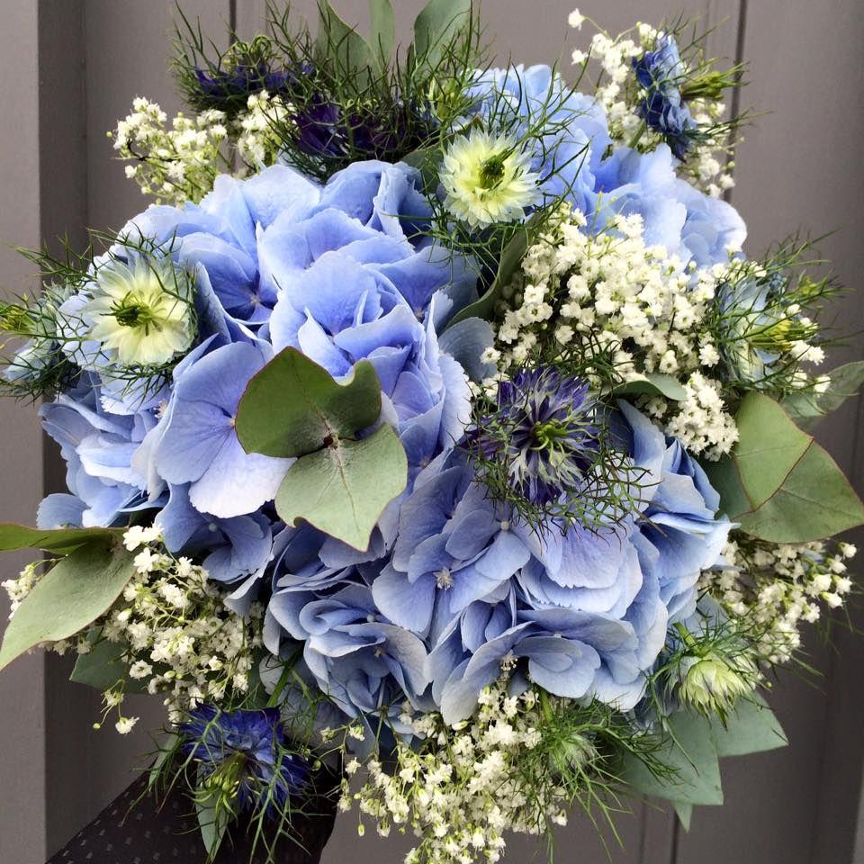 Blue hydrangea blue nigella and gypsophila bridal bouquet
