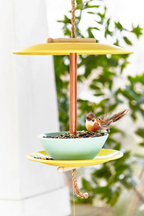 Give your birds a brand new perch by turning old dishes into a chic bird feeder.  Get the tutorial.