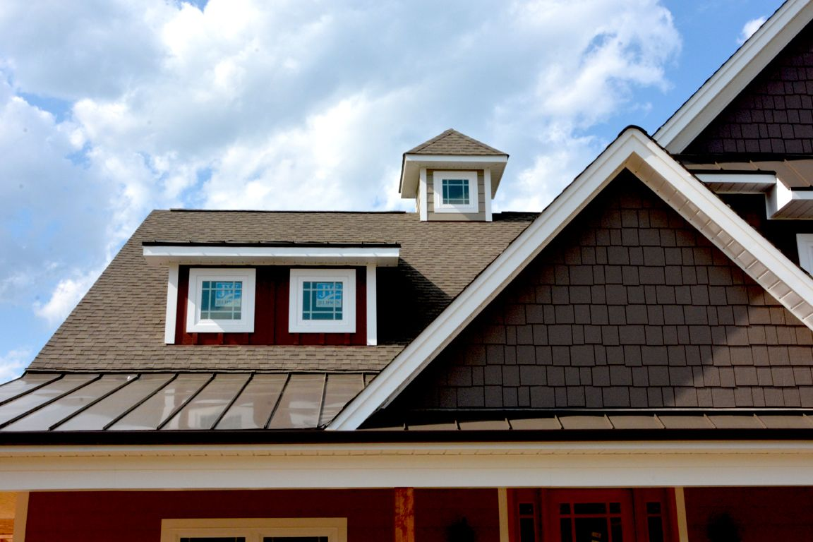Craftsman style exterior with a brown tin