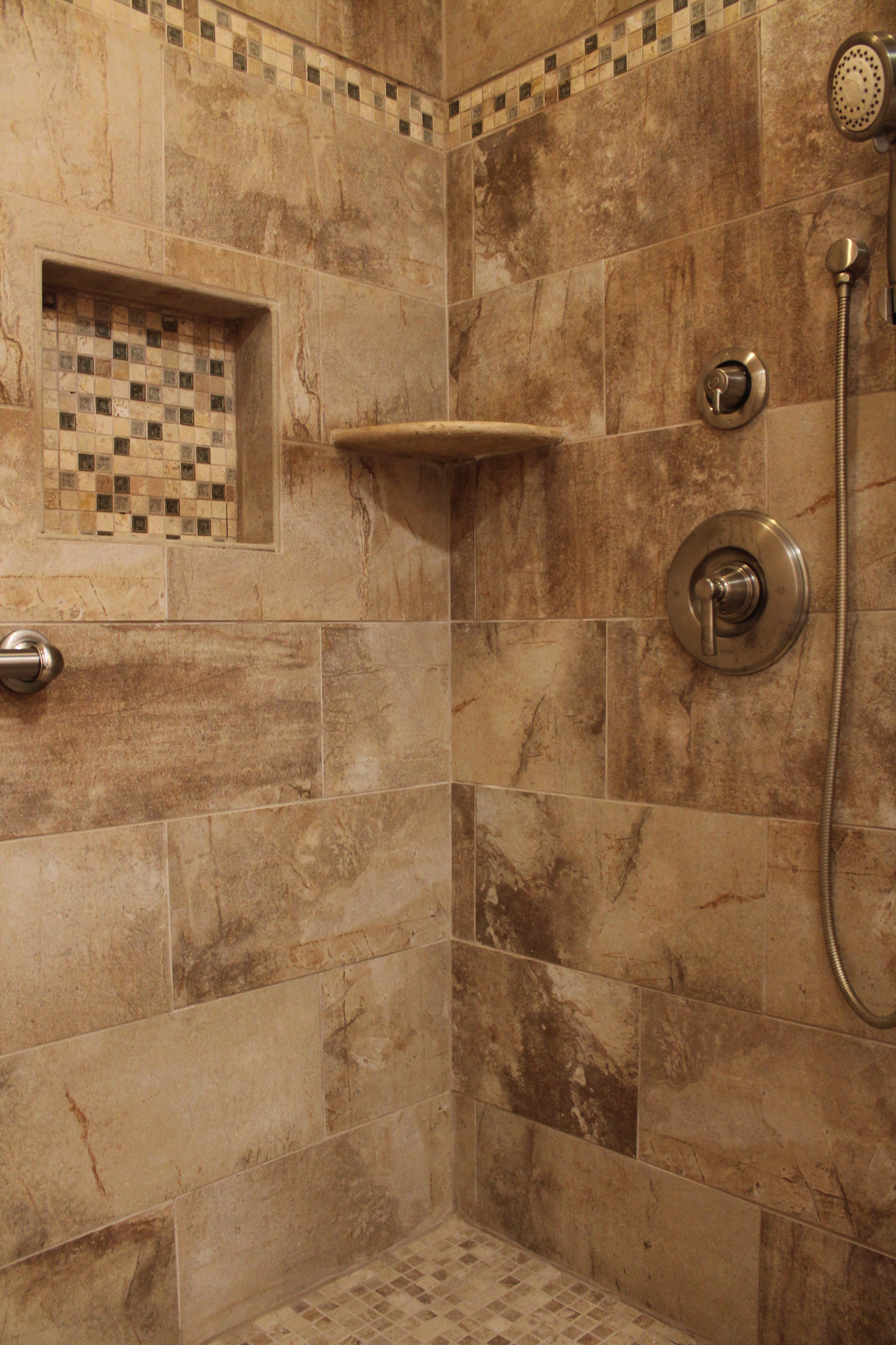 Shower design with beige earth tone tile and mosaic for Earthy bathroom ideas