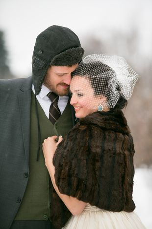 Winter wedding photo idea - bride in fur stole and groom in gray winter hat  for outside photos  Erin Johnson Photography  f22c65d23b1