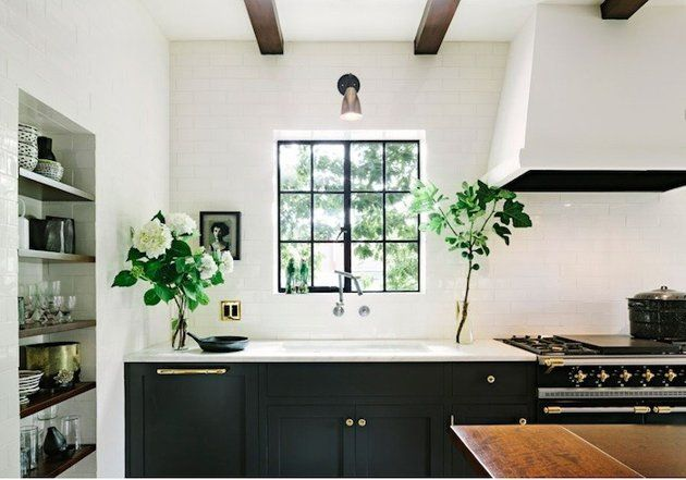 Darker cabinets and white walls and appliances give you a ...