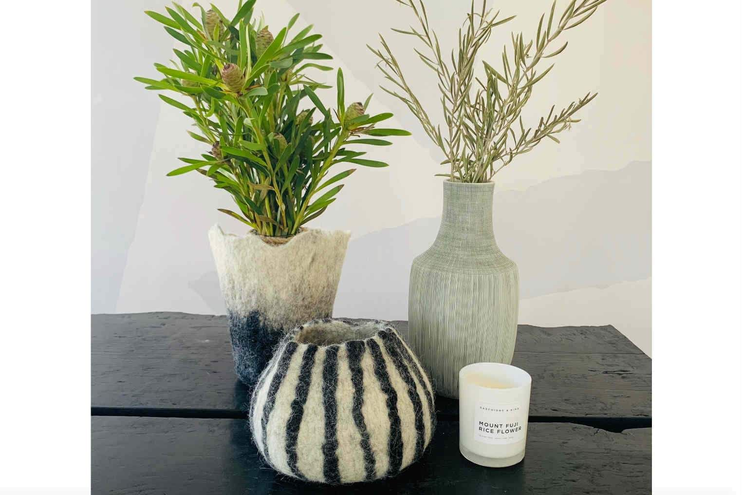 Felted Décor Vases - Kanju Interiors - Luxury African Design - these hand felted vases are made from karakul wool so they are luxurious and durable. Perfect gift to add some warmth, texture, style, and color to anyone's home. Each unique vase comes in a variety of sizes and colors and are great gifts for anyone who enjoys a unique, fun touch of style. Visit our Website for more info.  #giftideas #africandecor #easygift