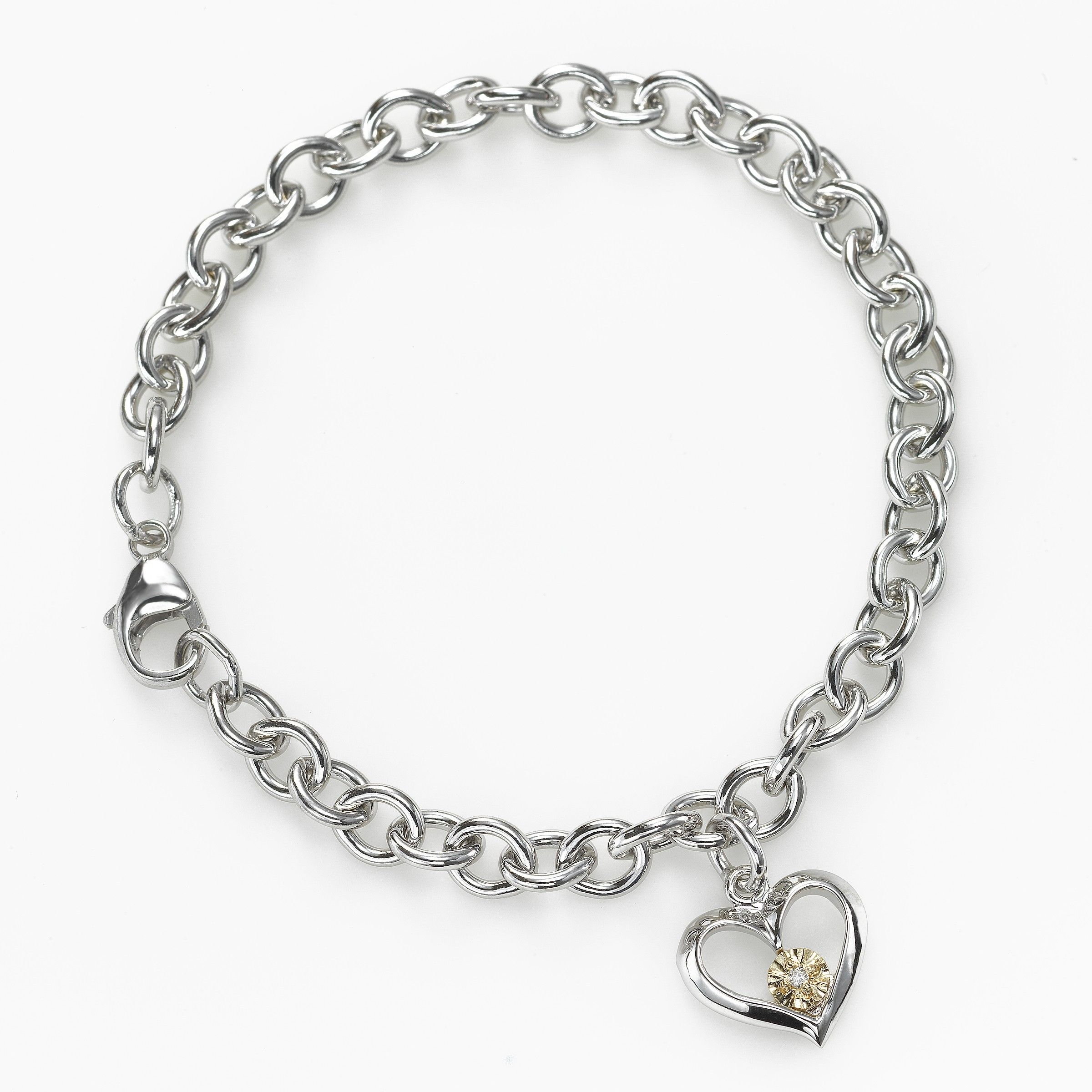 This sweet bracelet would make a perfect Valentine for a special young lady. The sterling silver links are accented by an open heart, with an accent of 14k yellow gold and a single diamond, .01 carat. The lobster clasp closure is cleverly designed to be attachable at any length along the bracelet, to be worn now and for years to come. Length overall is 6.75 inches. You'll also receive 15% OFF, SITE WIDE between now and Feb 12 -- just enter VALENTINE at checkout.