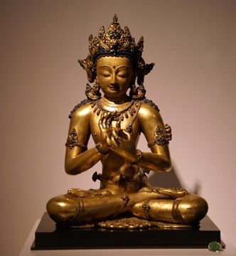 Gilt Copper figure of Maitreya Buddha, inset with Silver and Semi-Precious Stones, Tibet, 13th Century