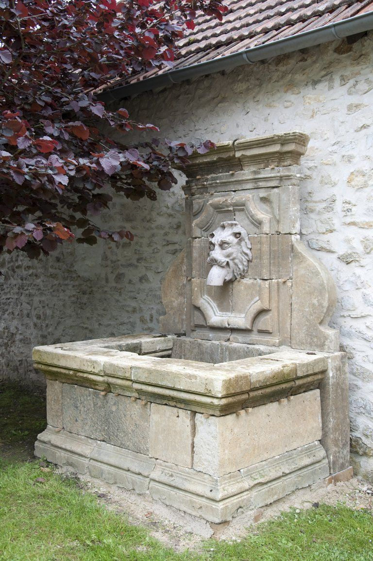 A French Louis the 14th style stone wall fountain maded of architectural reclaimed element dated 19th C.