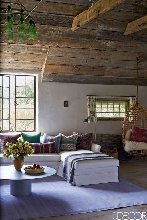 In the living room of an 1870s carriage house in Bedford, New York, the purple…