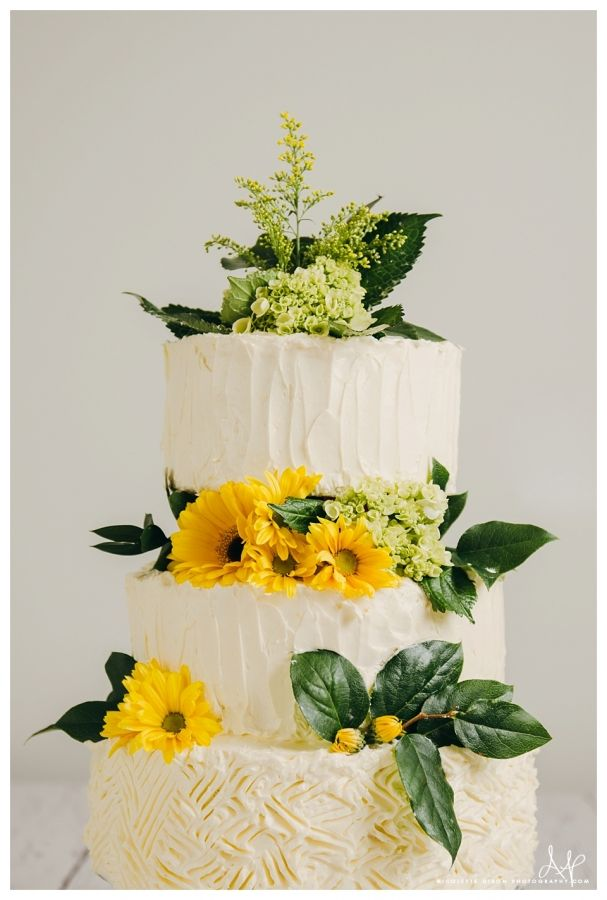 Buttercream Three Tiered Wedding Cakes With Flowers Smore Cake Lincoln Nebraska Bakery
