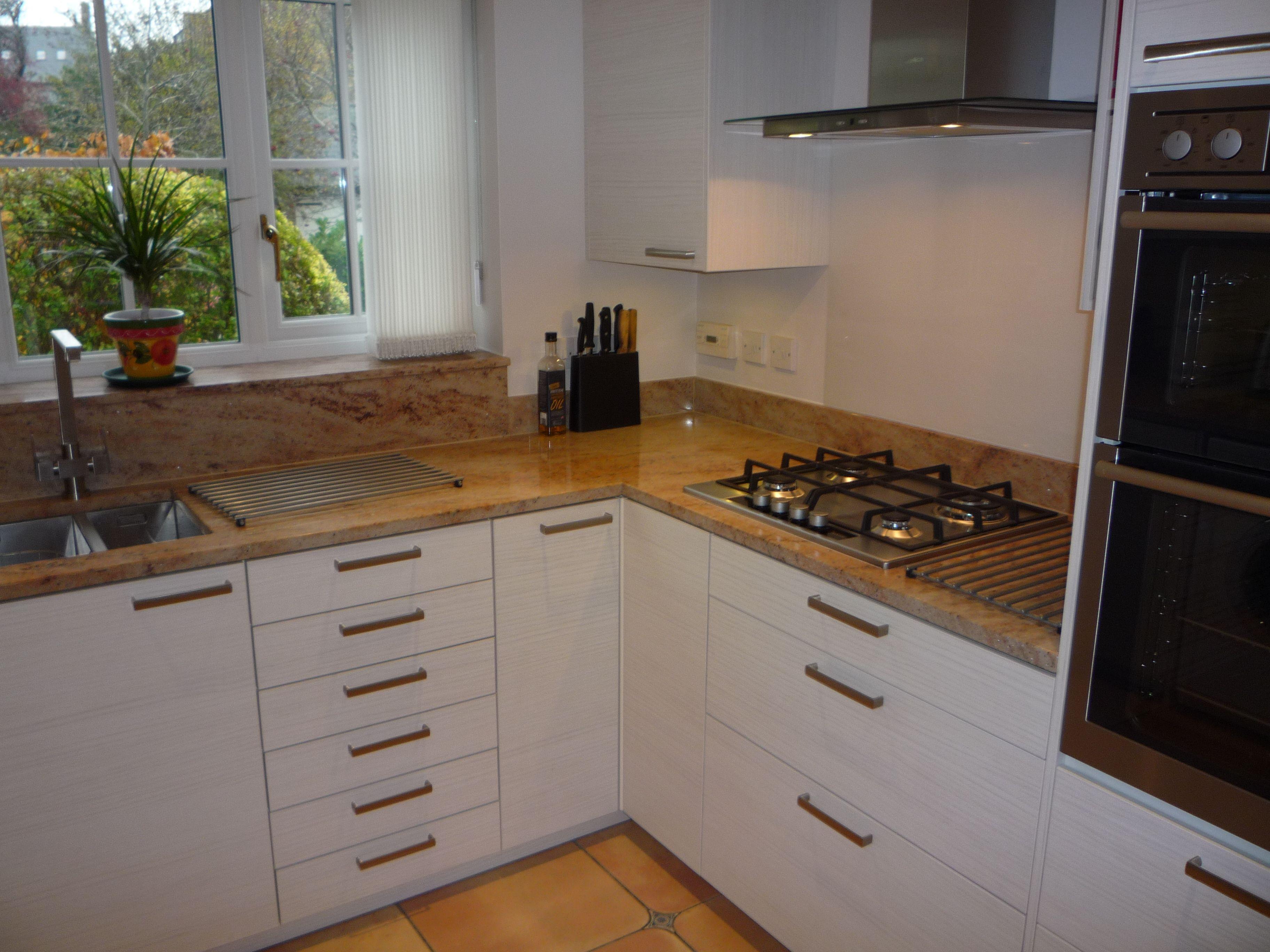 Hacker Systemat Kitchen In White Pine With Granite Worktops