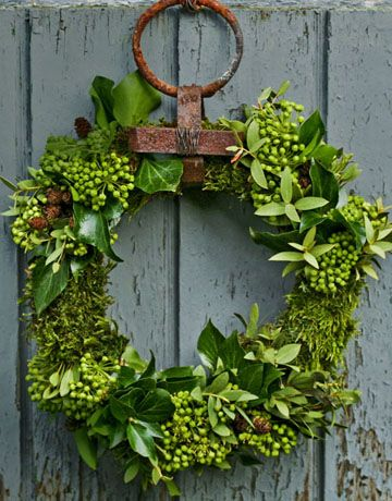 handmade evergreen wreath on the front door. This one by Minna Mercke Schmidt is constructed from moss, ivy, and eucalyptus wired into a frame