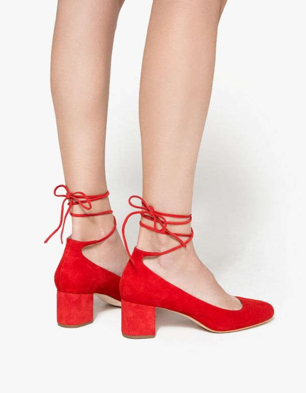 From Loeffler Randall, a classic lace up heel in Flame. Featuring a suede  upper