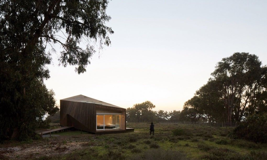 Two protective layers keep this angular house in Chile cool in the ...