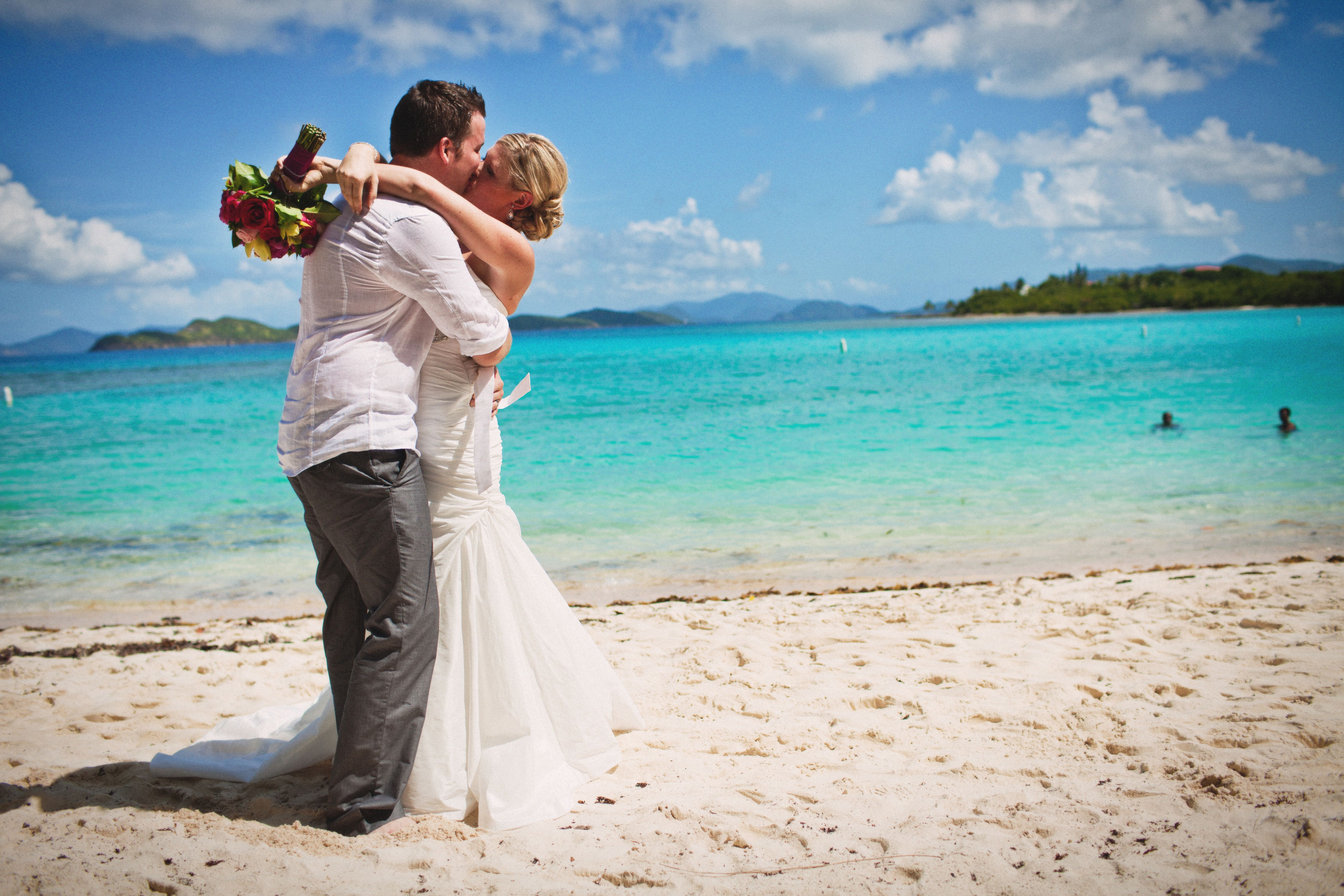 Kissing after wedding ceremony on Lindquist Beach, St Thomas USVI ...