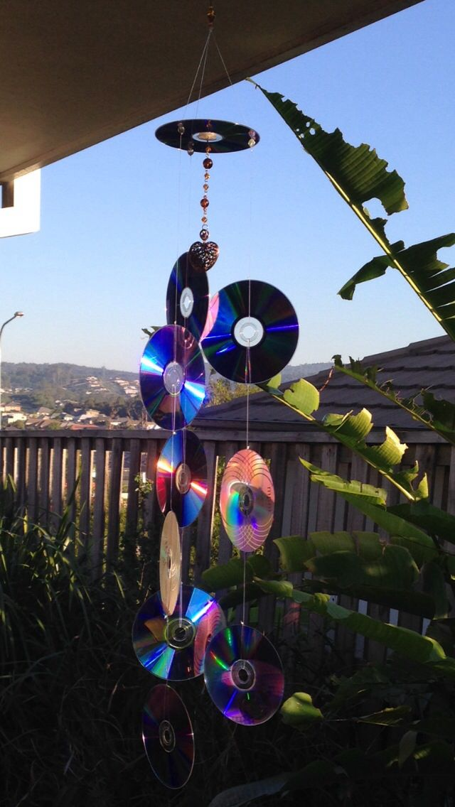 Recycled CDs Into Sun Catcher To Keep Birds Off Your Porch.