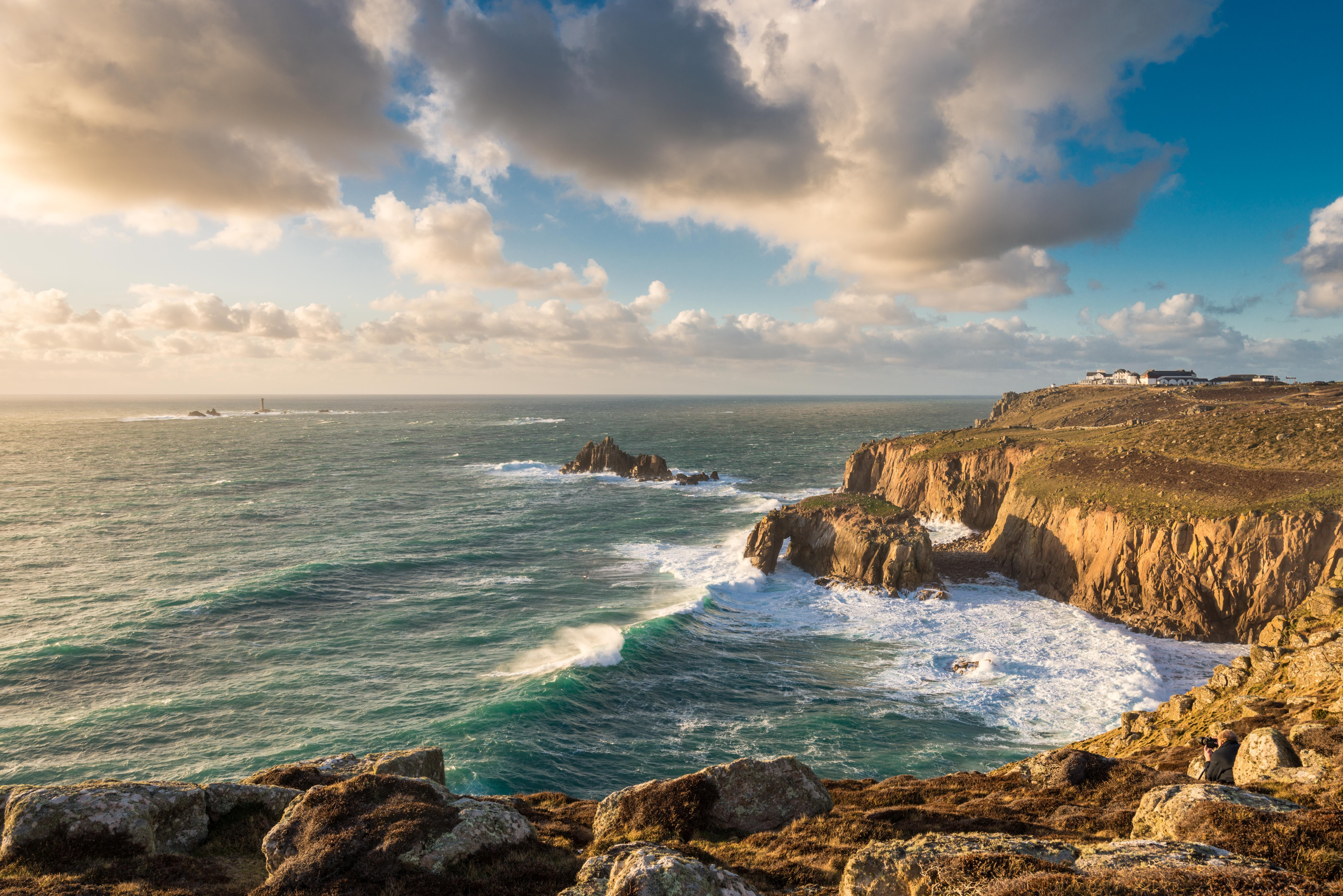 Brown Mountains And Rock Formation Near Sea With Blue Sky And White Clouds Lands End Cornwal Beautiful Places To Visit Most Beautiful Places England Wallpaper