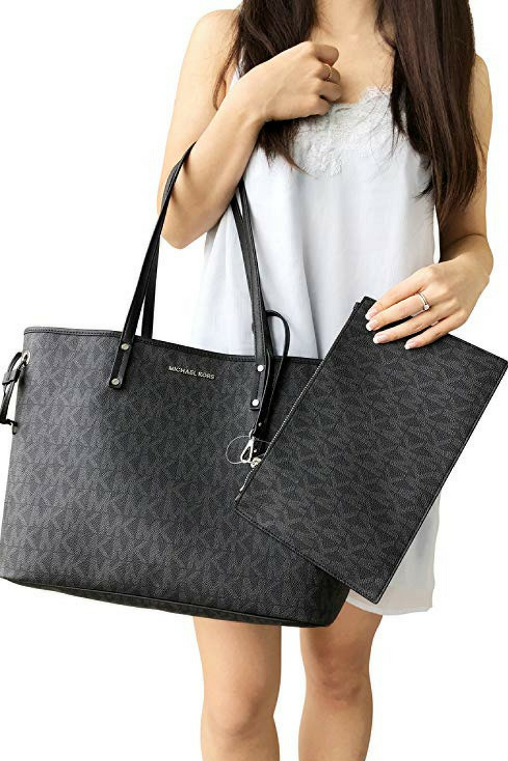 0d37444c42f6 Michael Kors Jet Set Travel Large Drawstring Tote Black MK Signature This  classic carryall is just the ticket for on-the-go style.